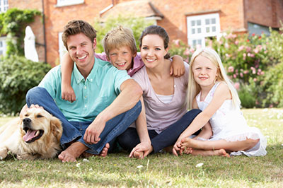 image of family sitting in yard